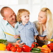 Happy family preparing a healthy dinner at home. — Foto de Stock