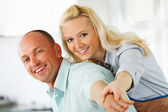 Embraced couple enjoying in their kitchen — Stock Photo
