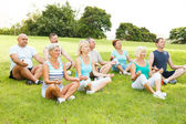 Group of People practicing yoga — Stock Photo