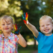 Happy kids with painted hands — Stock Photo
