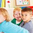 Preschoolers  in the classroom with teacher — Stock Photo