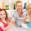 Stock Photo: Preschoolers in the classroom with teacher