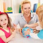 Preschoolers in the classroom with teacher — Stock Photo