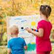 Stock Photo: Pre-school children painting