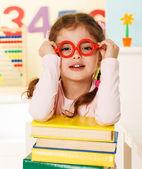 Little genius with books — Stock Photo