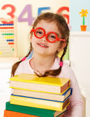 Little genius with books — Stock Photo