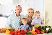 Happy family at kitchen. — Stockfoto