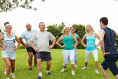 Active Mature People with fitness Trainer — Stock Photo