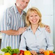 Cheerful mature man and woman smiling together — Stock Photo #46009407