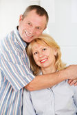 Cheerful mature man and woman smiling together — Stock Photo