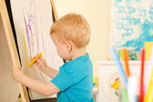 Little genius  with yellow chalk — Stock Photo