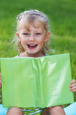 Little genius  with green book — Stock Photo