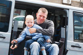 Disabled Men with son on Wheelchair Lift — Stock Photo