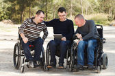 Disabled friends with digital Notebook — Stock Photo