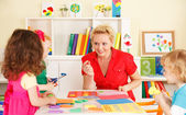 Pre-school children in the classroom with the teacher — Stock Photo