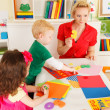 Preschoolers in the classroom with the teacher — Stock Photo #50189327