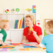Pre-school children in the classroom with the teacher — Stock Photo #50517523