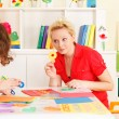 Pre-school children in the classroom with the teacher — Stock Photo #50517541