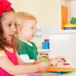 Pre-school children in the classroom — Stock Photo #50517551