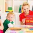 Pre-school children in the classroom with the teacher — Stock Photo #50517621