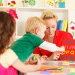 Pre-school children in the classroom with the teacher — Stock Photo #50517659