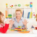Teacher talking with children. — Stock Photo #50517661