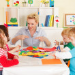 Pre-school children in the classroom with the teacher — Stock Photo #50517669