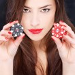 Woman holding chips for gambling — Stock Photo