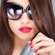 Woman with sun glasses holding can — Stock Photo #13922155