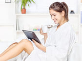 Woman in bathrobe relaxing at home — Stock Photo