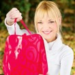 Woman showing her shopping bag — Stock Photo