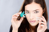Woman holding contact lenses wash case — Stock Photo