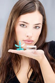 Woman holding contact lenses wash container — Stock Photo
