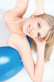 Woman donig exercise on pilate ball — Stock Photo