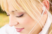 Close up of a woman with headphones — Stock Photo