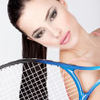 Pretty woman with tennis racket — Stock Photo