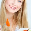 Blond woman eating salad — Stock Photo #18845867