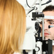 Medical attendance at the optometrist - Stock Photo
