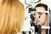 Medical attendance at the optometrist — Stock Photo