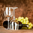 Glasses with wine bottle and grapes — Stock Photo