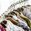 Stock Photo: Shirts on hangers