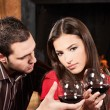 Couple drinking wine near fireplace - 