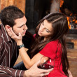 Woman caress her man near fireplace - Stock Photo
