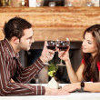 Couple cheers with wine - Stock Photo