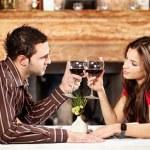 Couple cheers with wine — Stock Photo