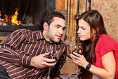 Couple in love near fireplace — Stock Photo