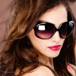 Woman with big black sun glasses - Stock Photo
