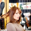 Satisfied customer in a hair salon — Stock Photo