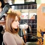 Dries hair in a hair salon — Stock Photo