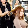 Dries hair in salon — Stock Photo
